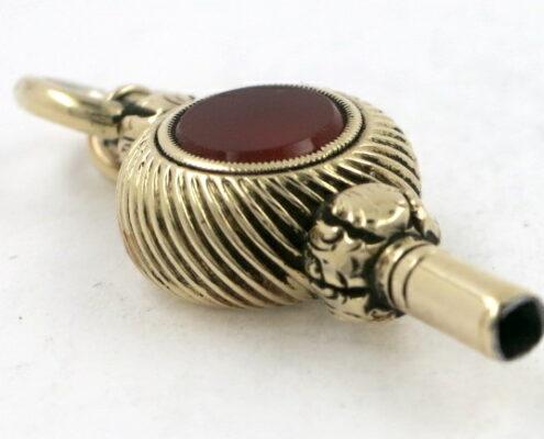 Gold watch key