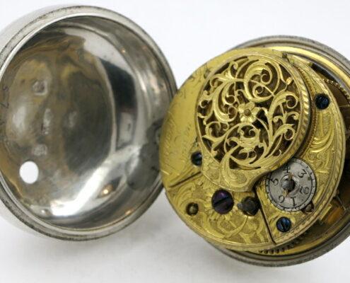 Silver repousse pair cases